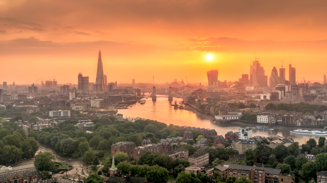 London skyline at dusk with views across the river Thames, including The Shard and the City of London.