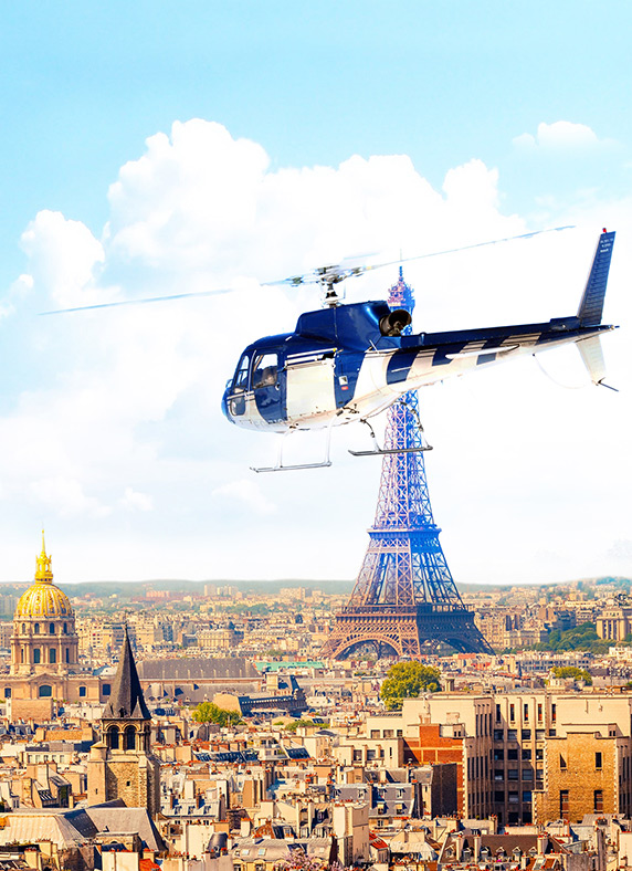 A helicopter flies above the city of Paris with Eiffel Tower in the background