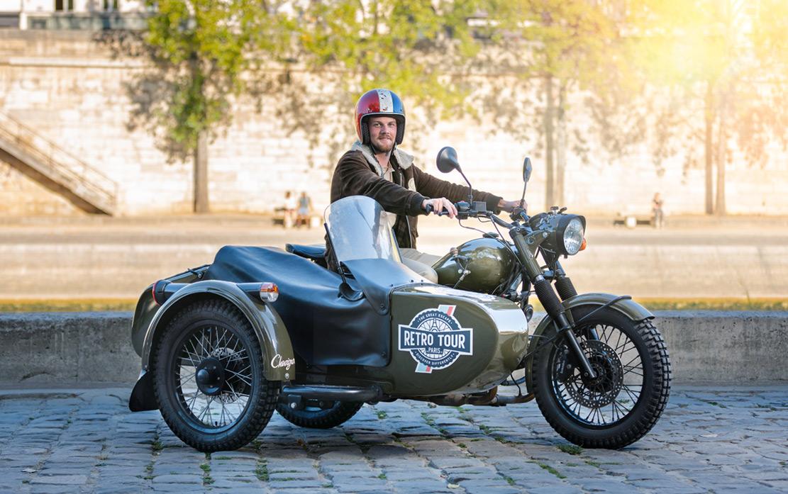 A man rides a Retro Tour Paris vehicle