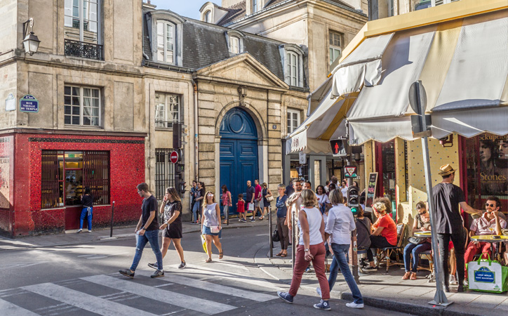 People wander the mazy streets of the Marais