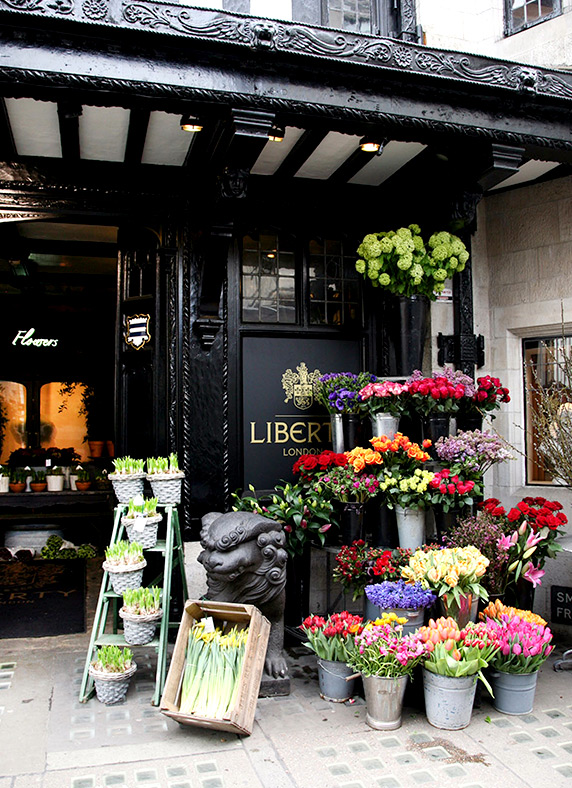 Colourful flowers decorate the mock-Tudor exterior of Liberty