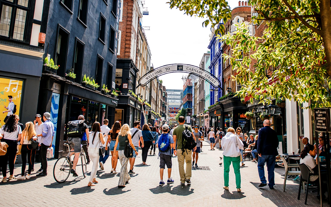People enjoy shopping on Carnaby Street