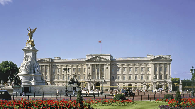 Buckingham Palace with flowers in the foreground